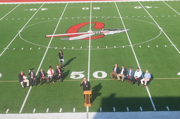 Local and school officials gathered on football field